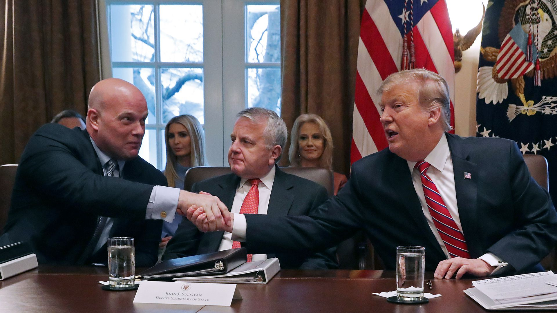 Matt Whitaker shaking Trump's hand