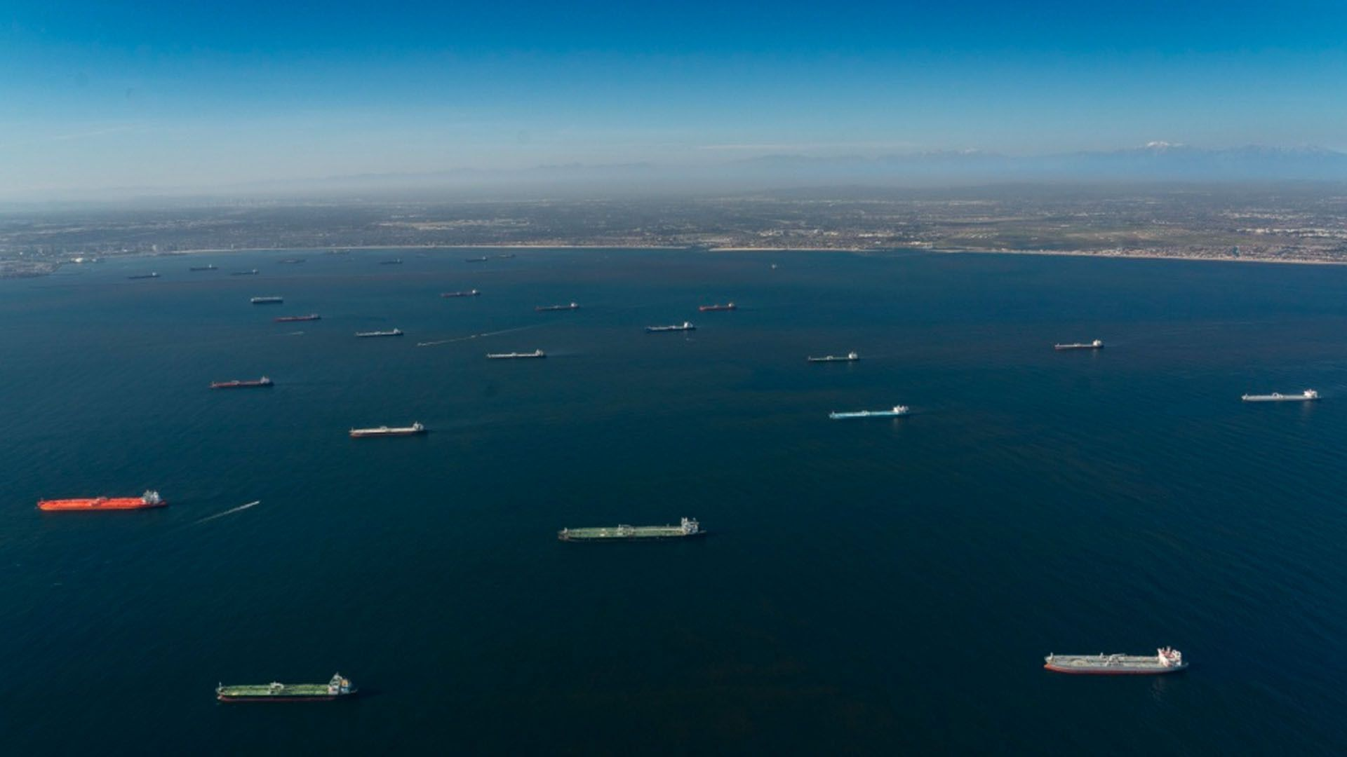 Oil tankers parked in the ocean.