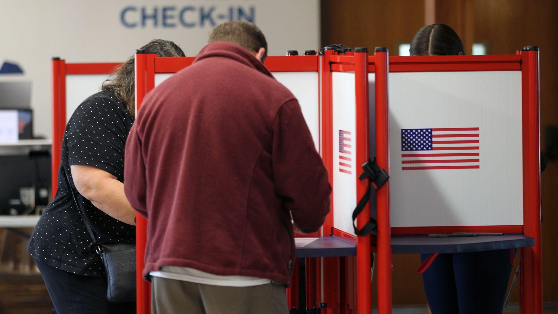 People cast votes in Louisville, Kentucky.