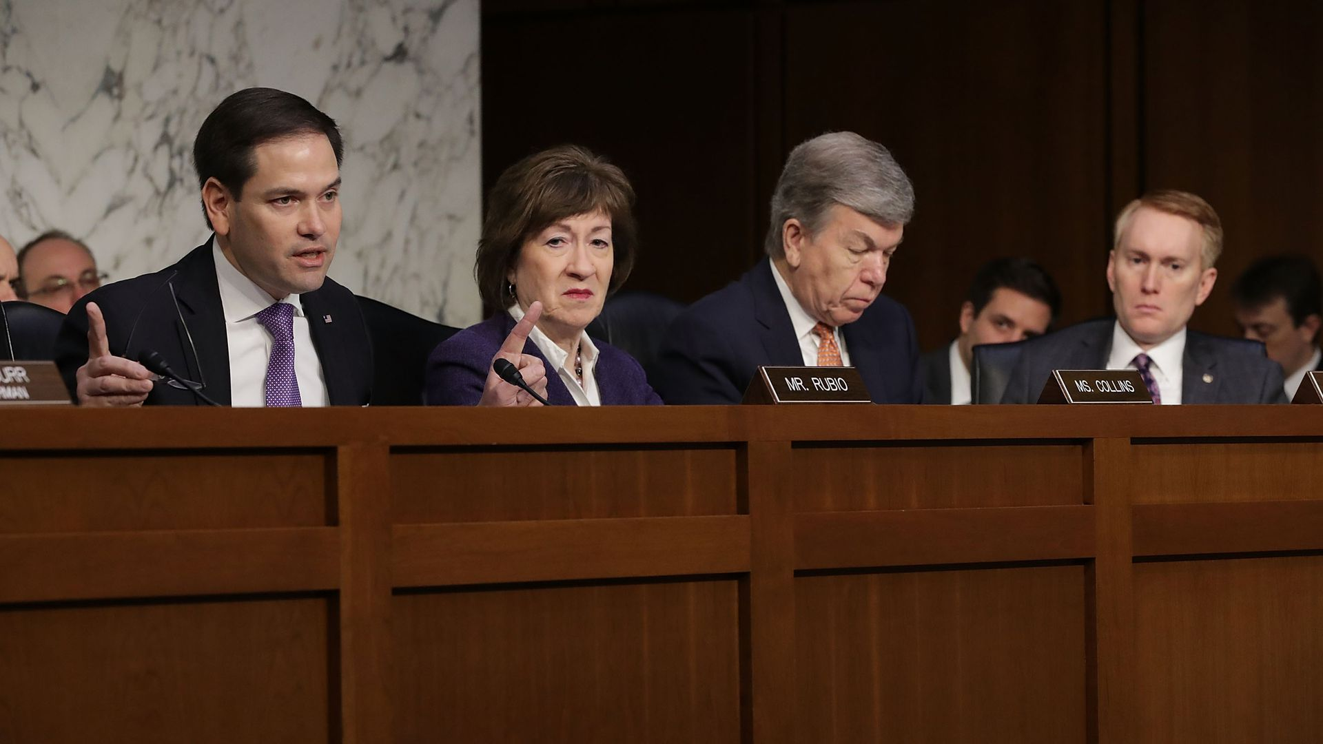 Senate Intelligence Committee members Marco Rubio, Susan Collins and others preside over a hearing.