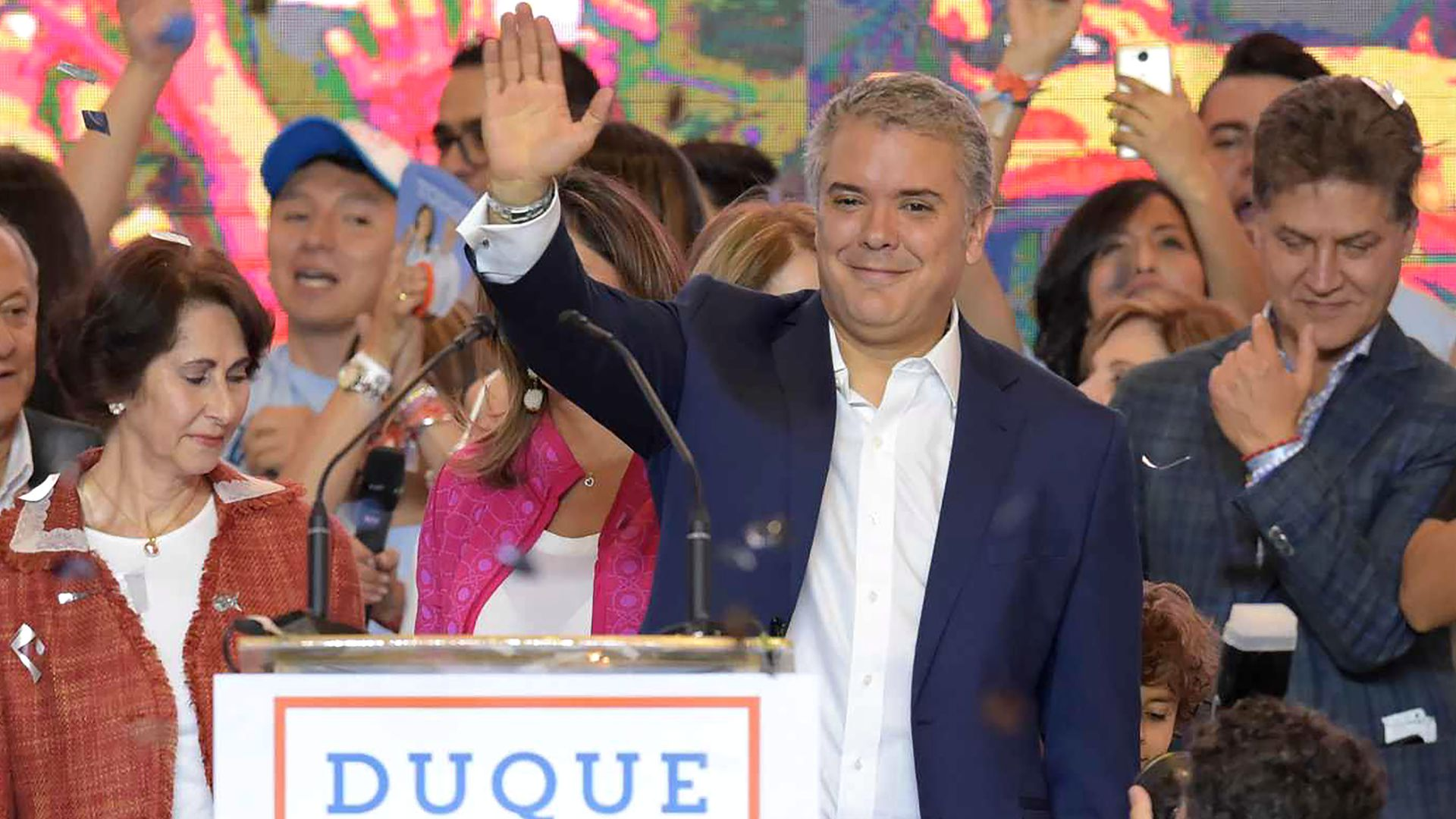 Ivan Duque waves to a crowd of supporters