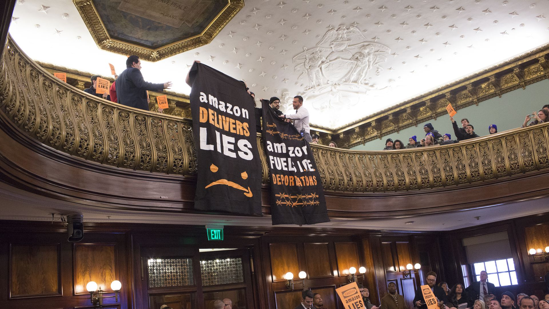 Photo of protestors at NYC council meeting on Amazon's deal to have HQ2 in Long Island City.