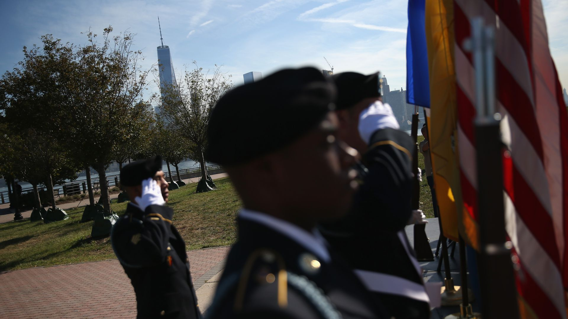 National Guard members saluting the flag.