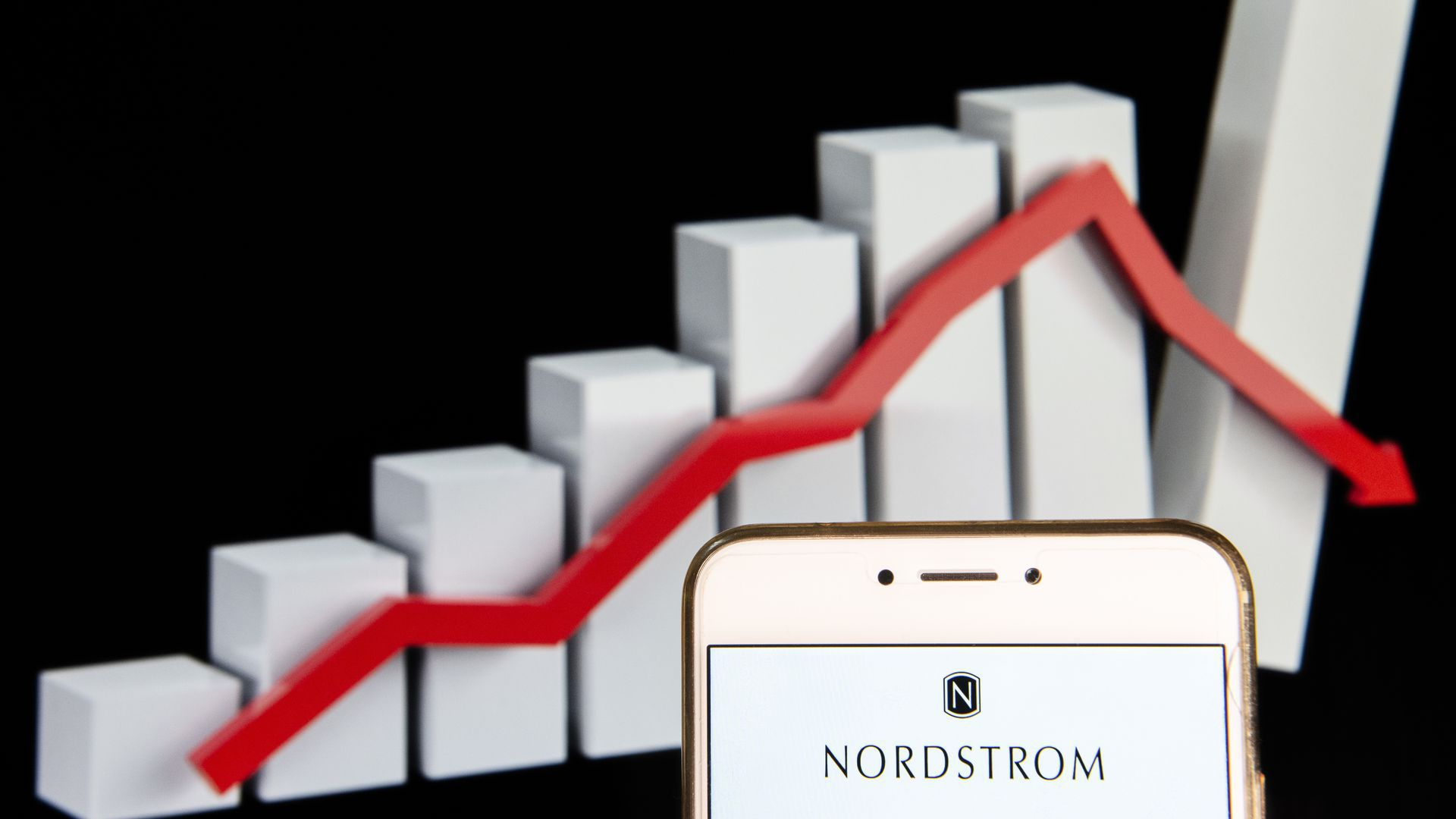 A bar graph with a phone that has Nordstom's logo on it