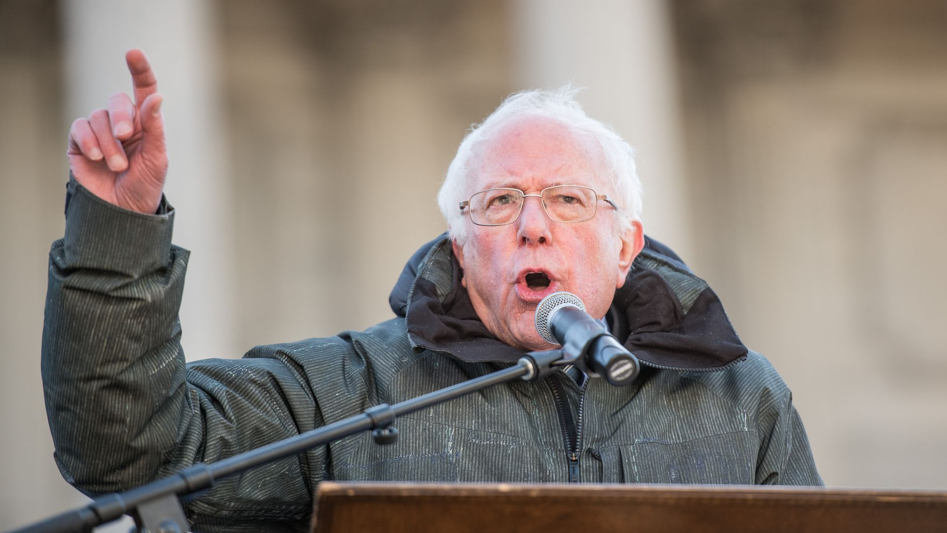 This is a photo of Bernie Sanders giving a speech and pointing in the air