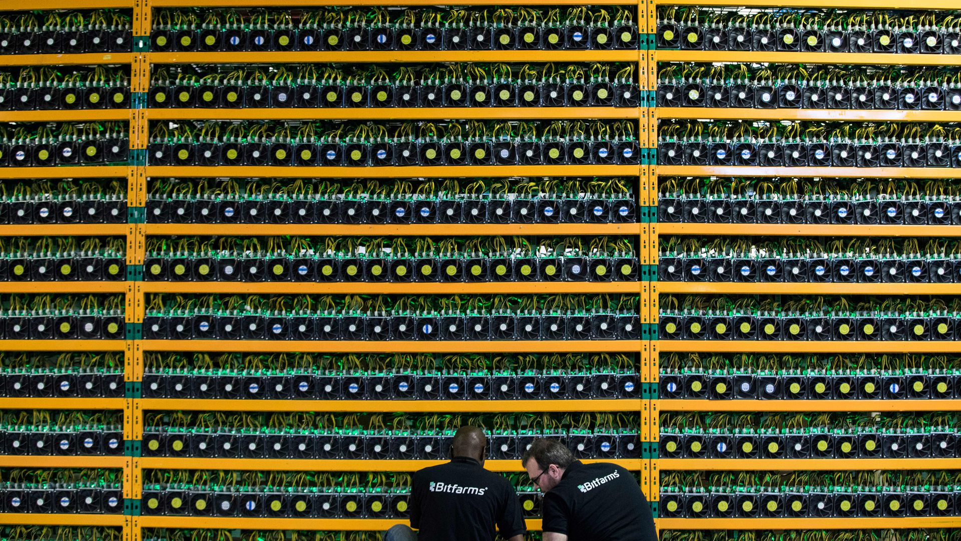 workers and servers at a bitcoin mining facility