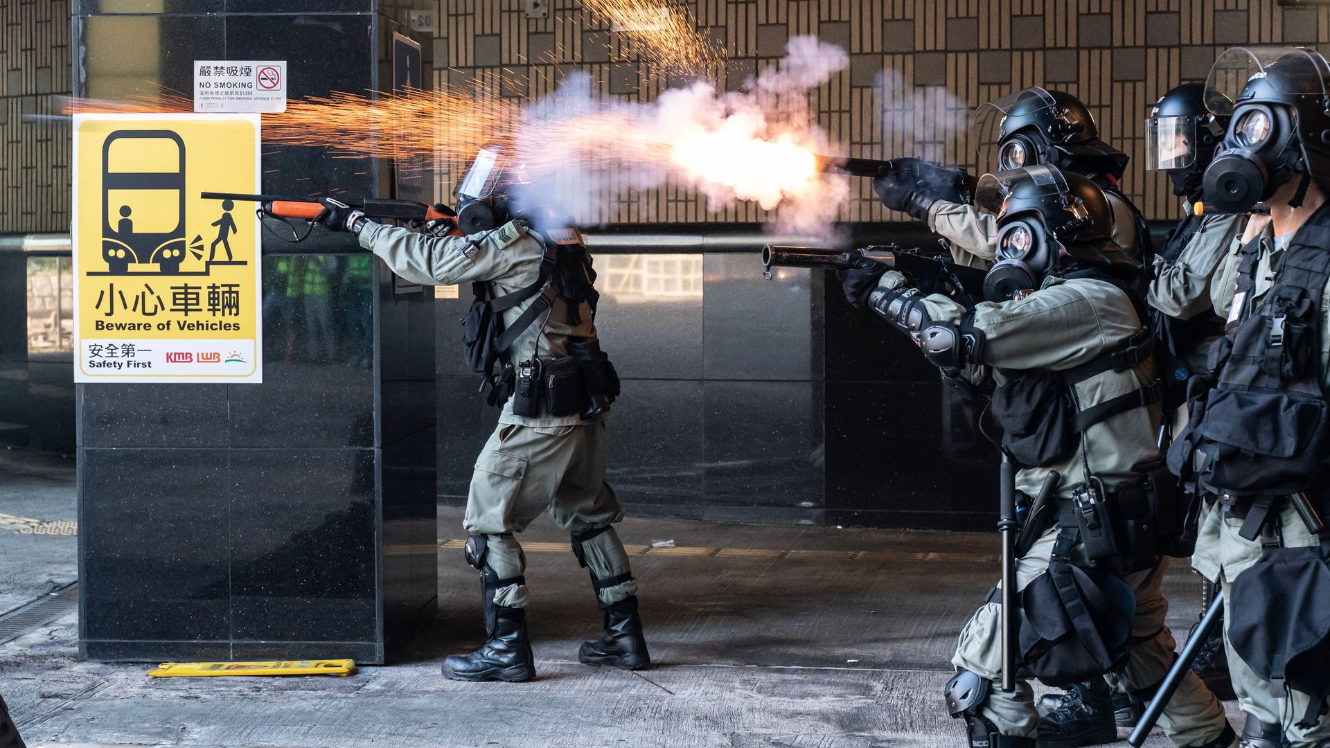 Riot police fire teargas and rubber bullets as protesters attempt to leave The Hong Kong Poytechnic University on November 18, 2019 in Hong Kong