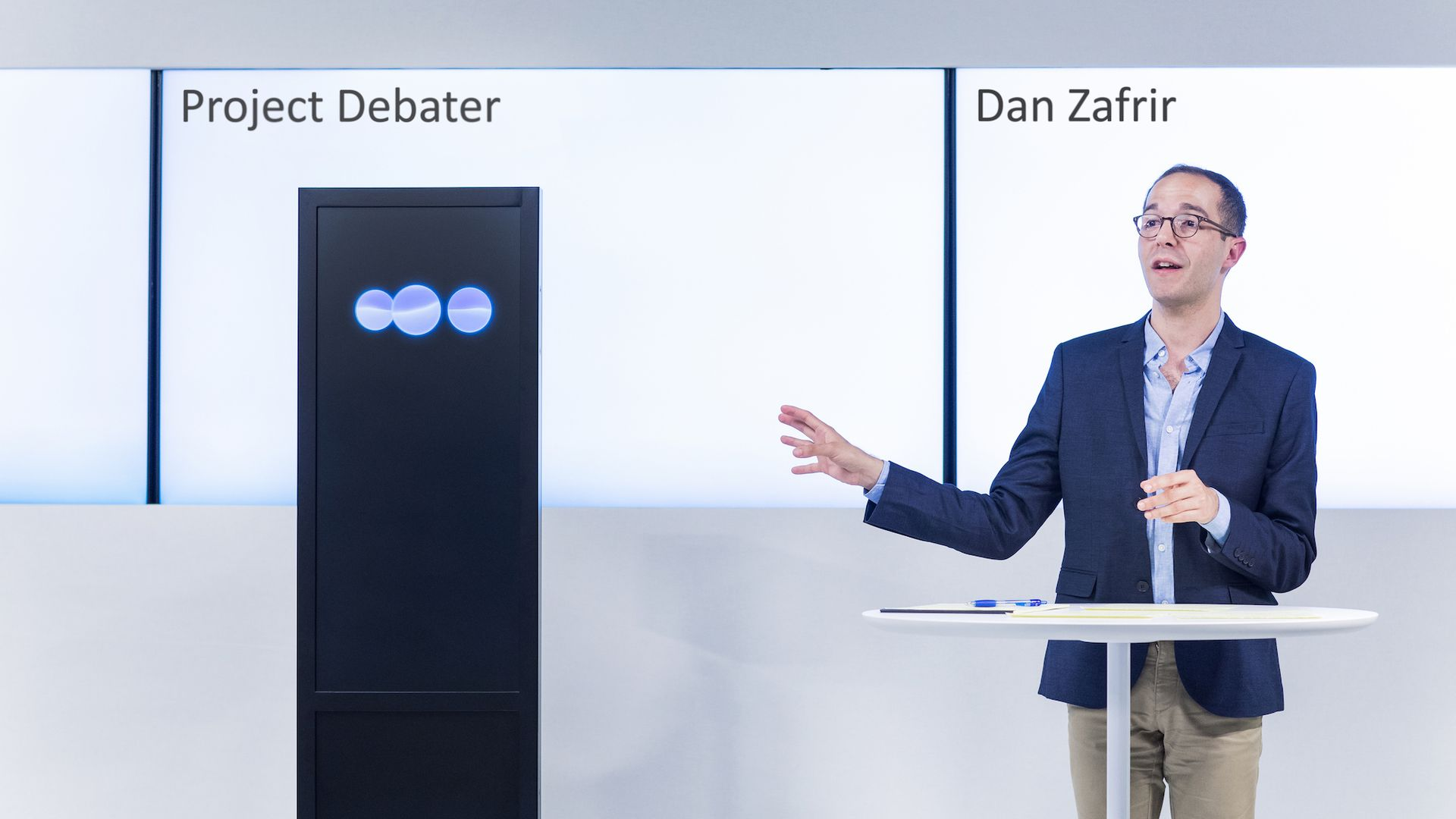 Human debater with box representing artificial intelligence debater
