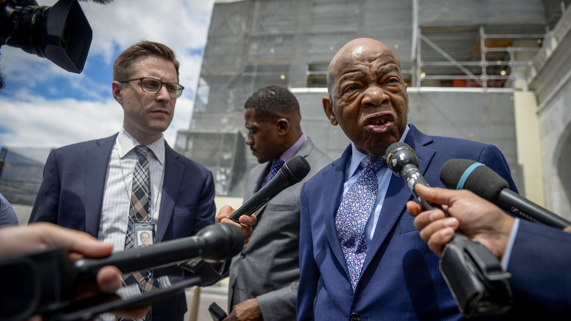Rep. John Lewis being interviewed by reporters outside of the Capitol building