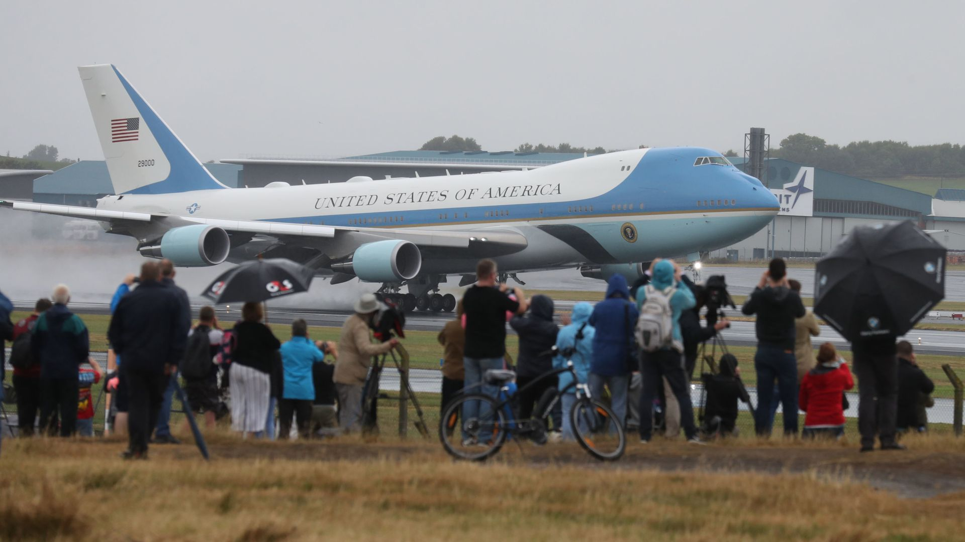 People watch as Air Force One takes off from Prestwick Airport in Ayrshire, as US President Donald Trump and his wife Melania leave the UK