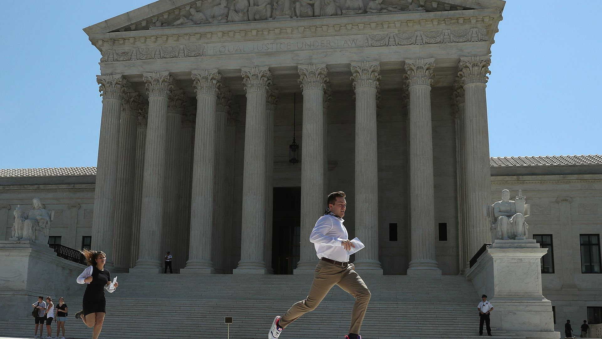 Interns running outside Supreme Court