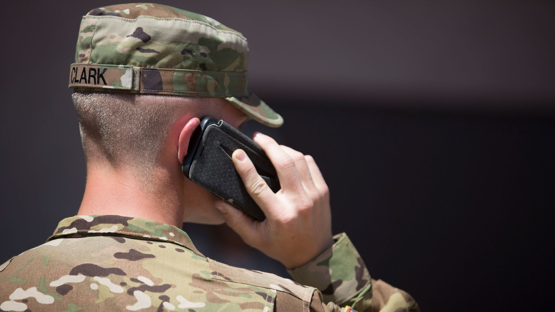 National Guard soldier talks into a phone