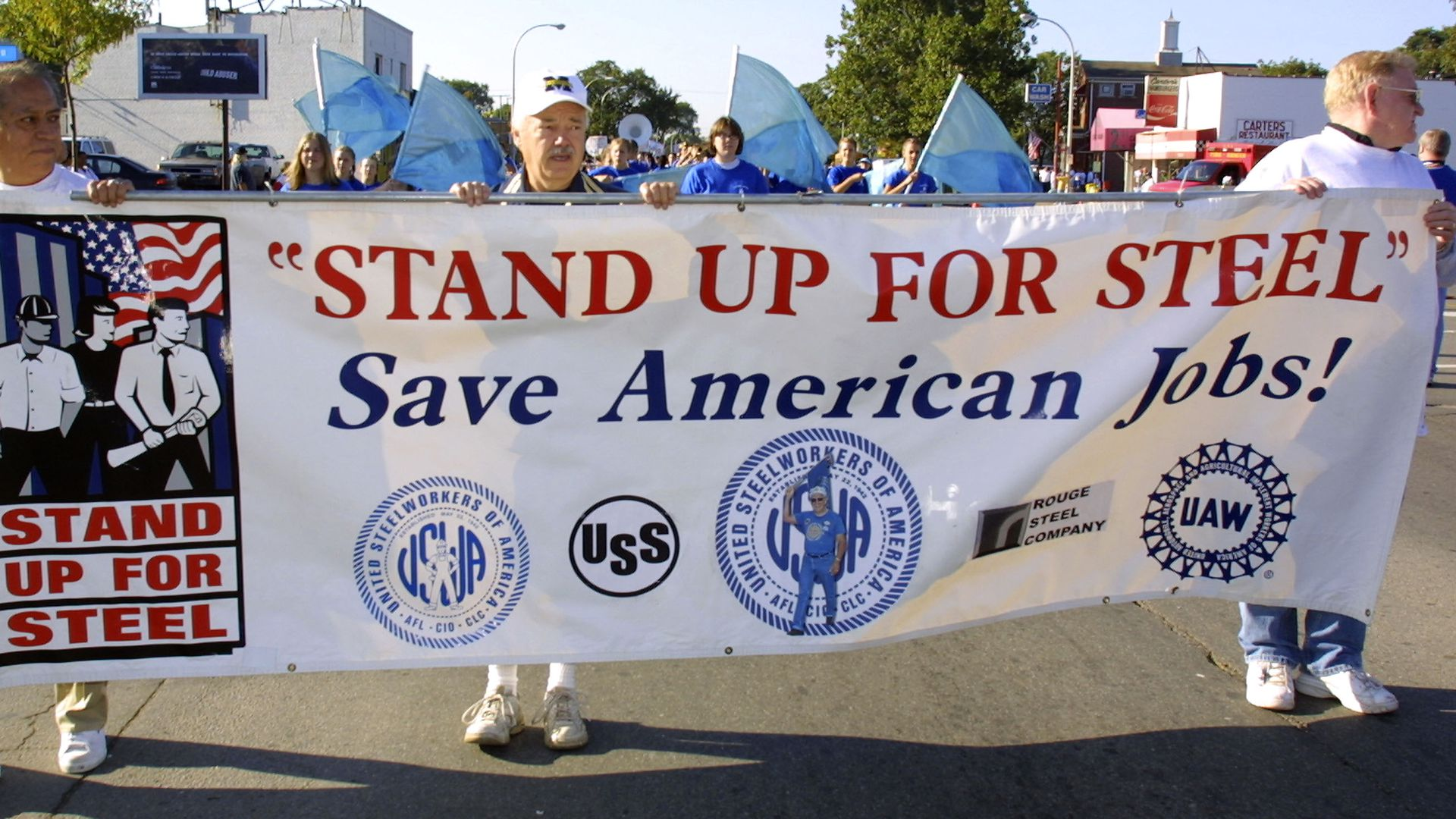U.S. steel workers with sign that says save american steel