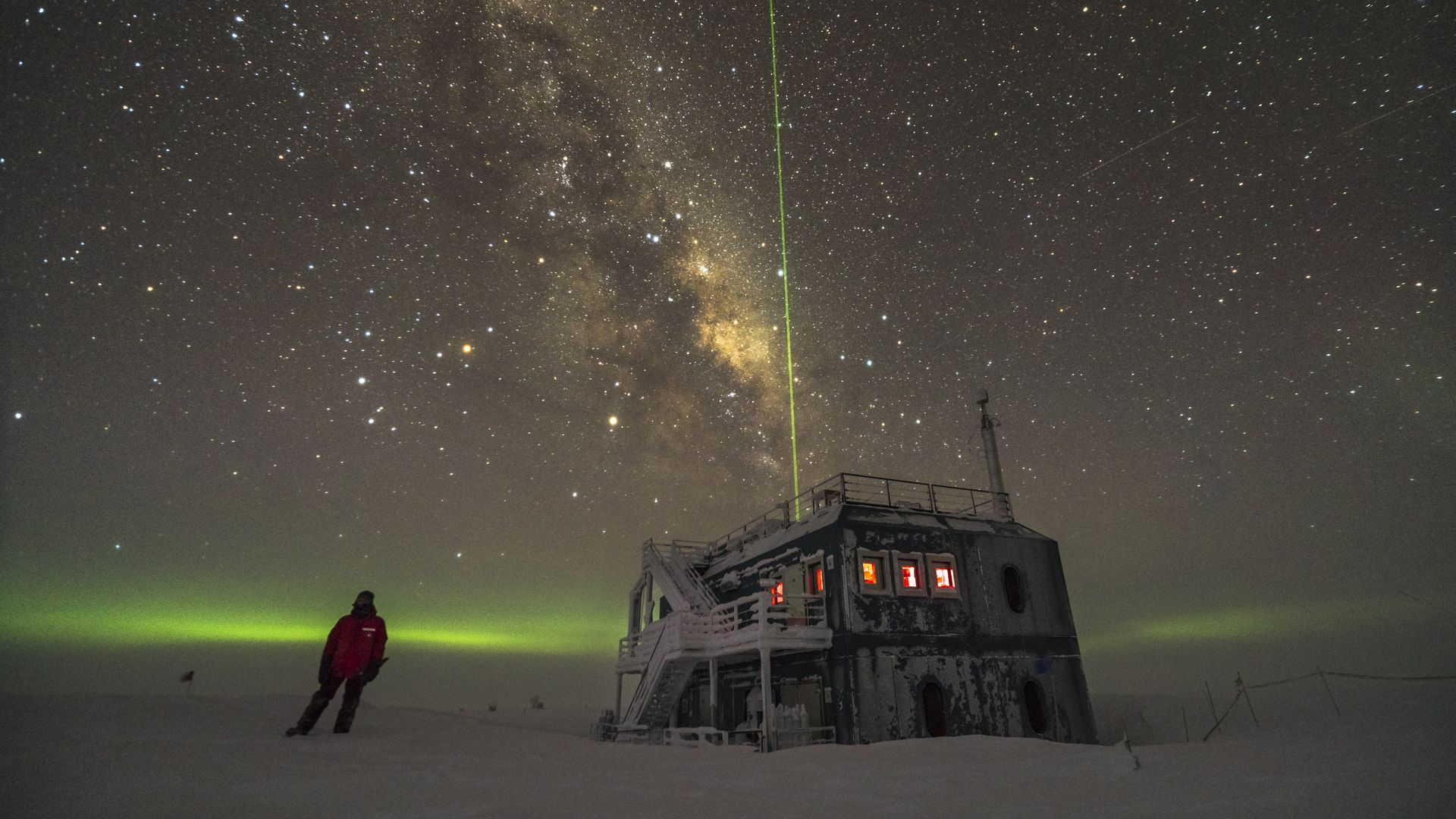 IceCube lab in Antarctica under the stars.