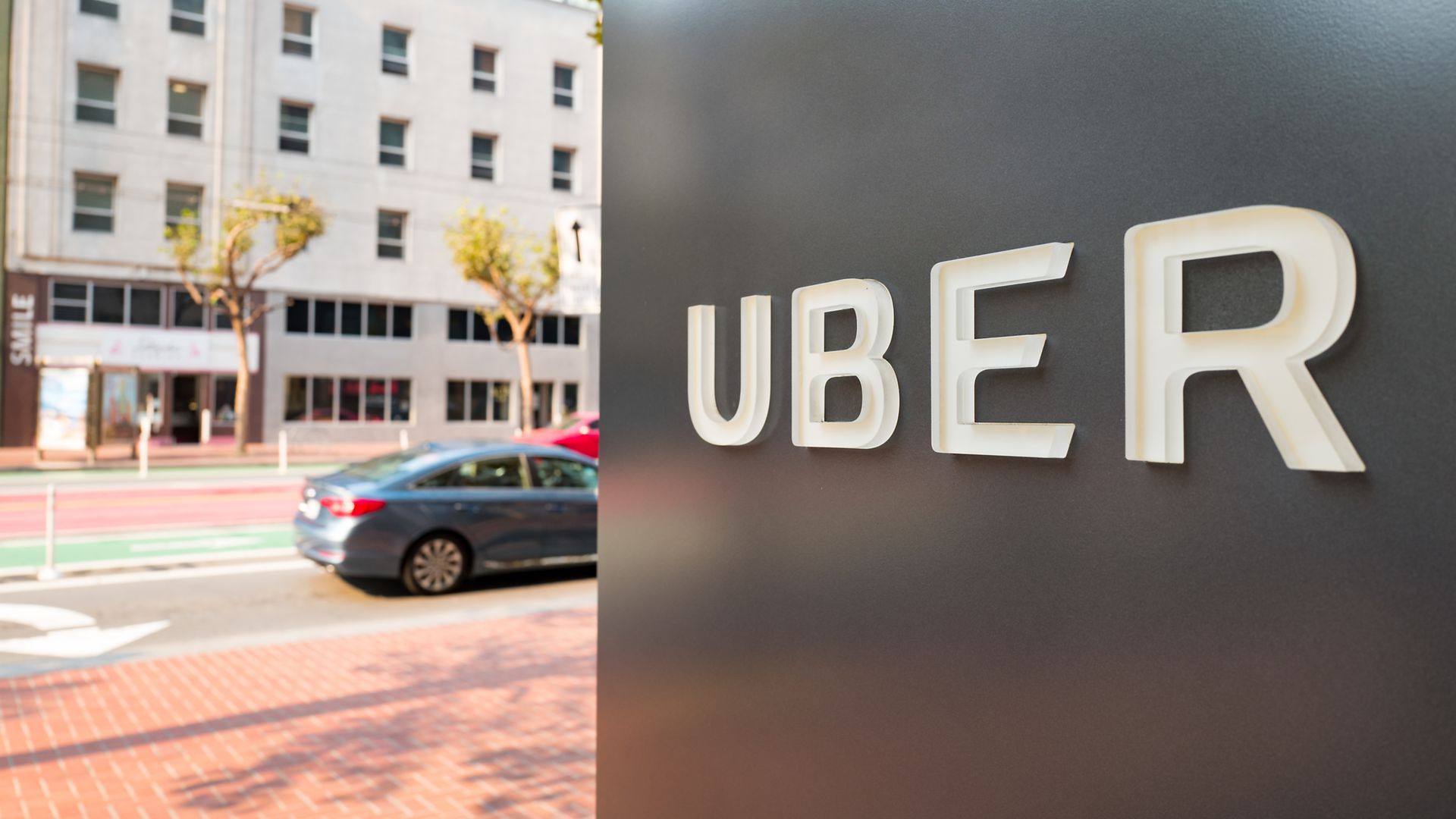 Sign with logo at the headquarters of ride-sharing technology company Uber in San Francisco, California