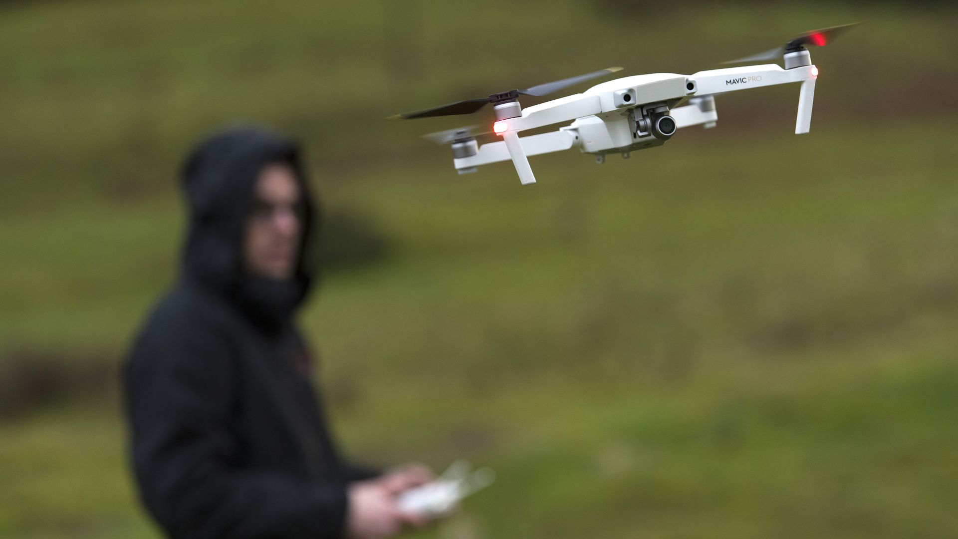 Drone operator flying a drone