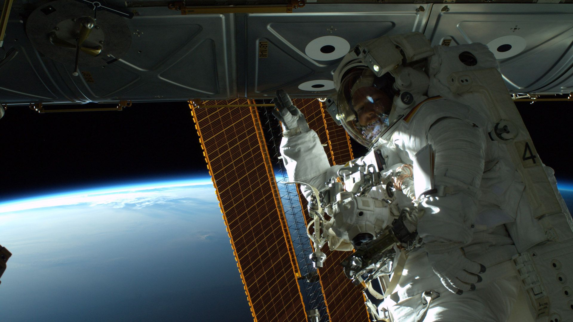 Astronaut conducting a spacewalk outside the space station.