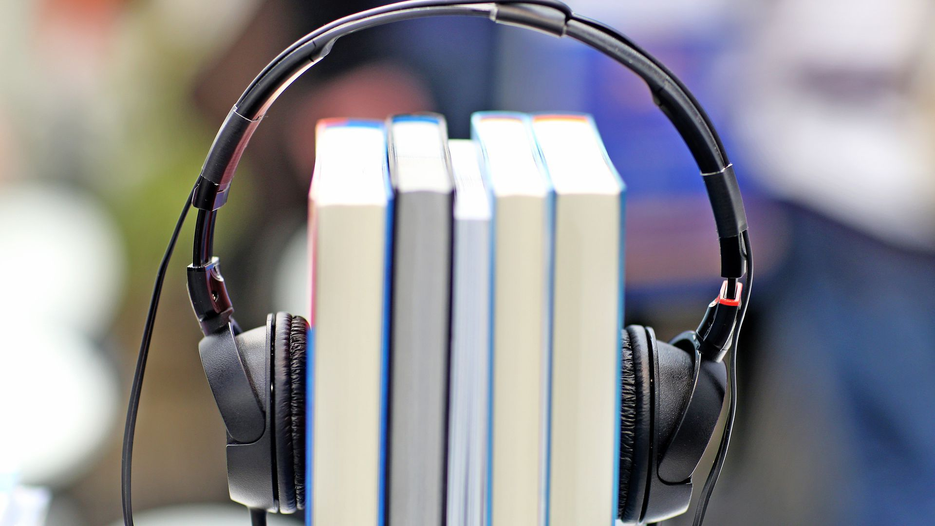 Books with headphones wrapped on them