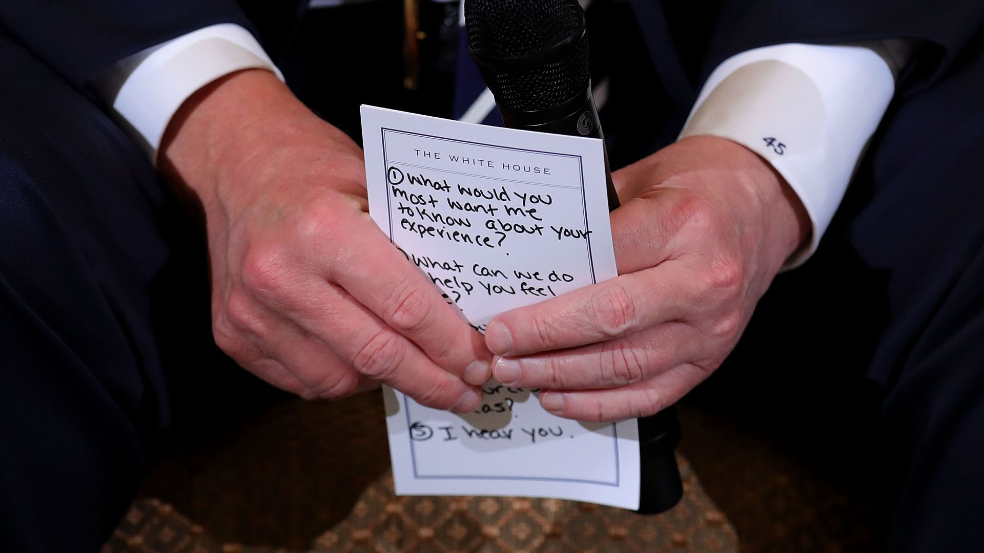 President Trump holds his notes