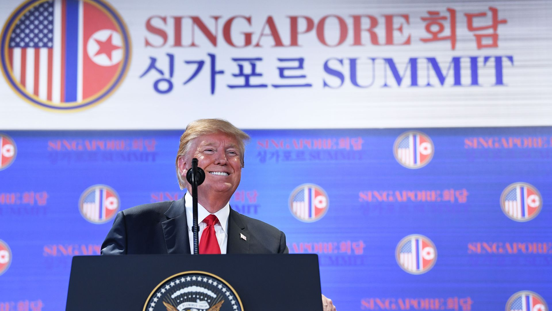 Donald Trump at lectern at Singapore summit