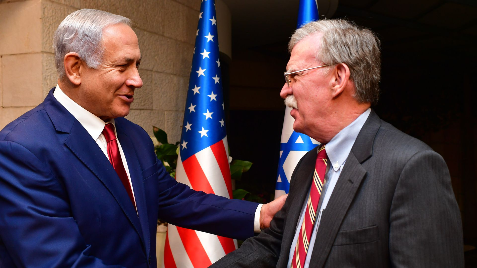 John Bolton shaking hands with Netanyahu