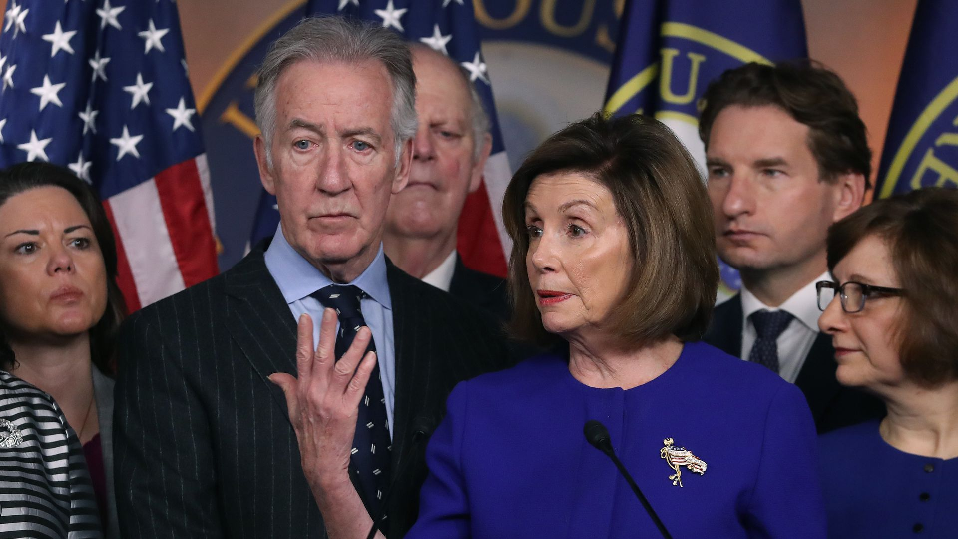 Nancy Pelosi and a group of Democrats at a press conference