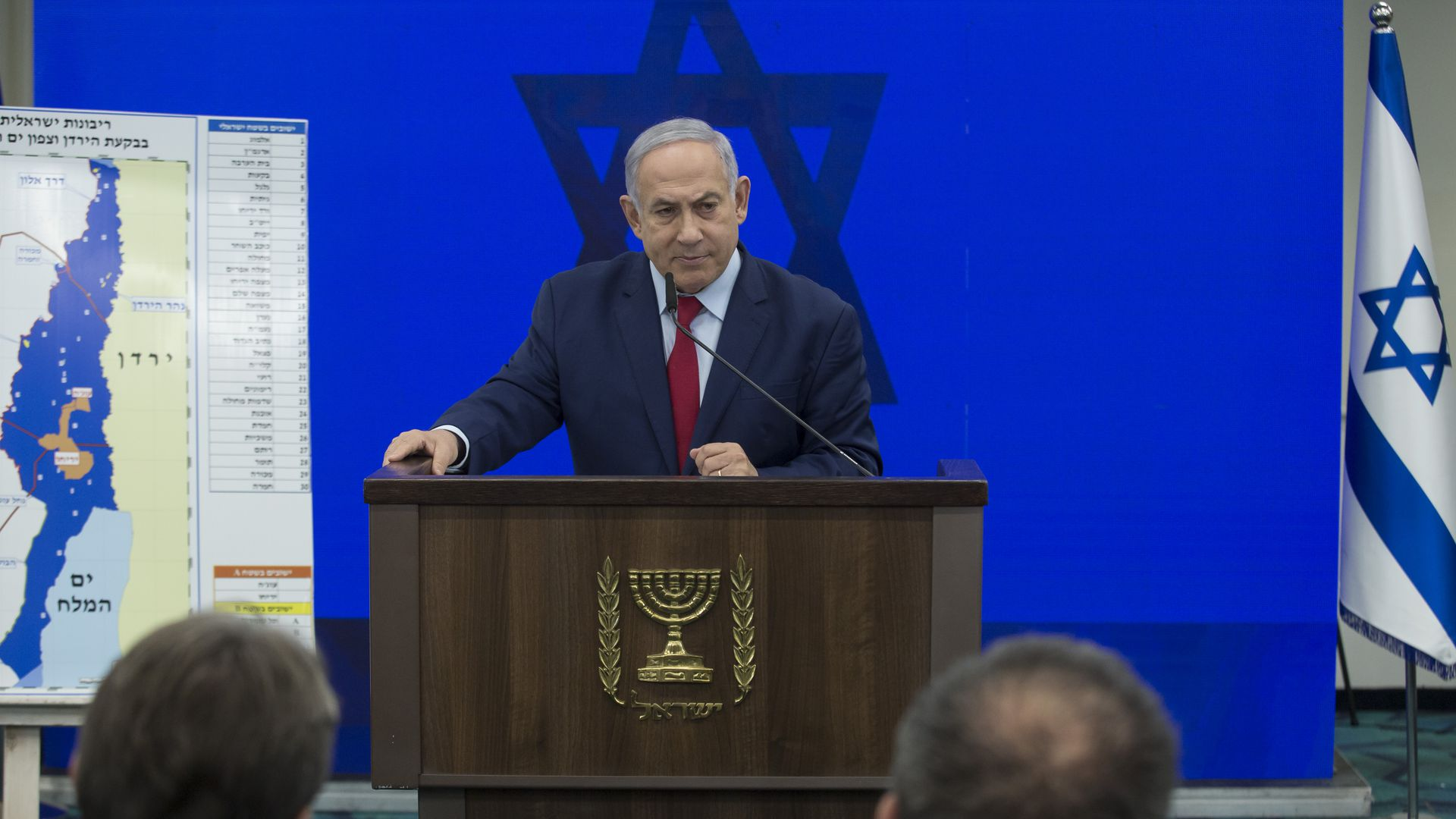Benjamin Netanyahu stands at a podium to announce annexation plans.