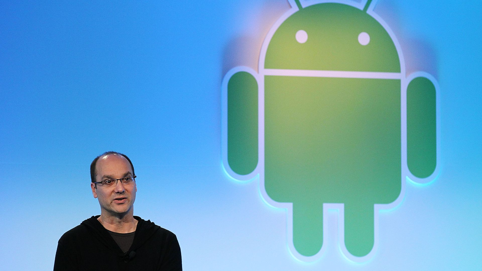 Andy Rubin standing on stage in a sweatsuit.