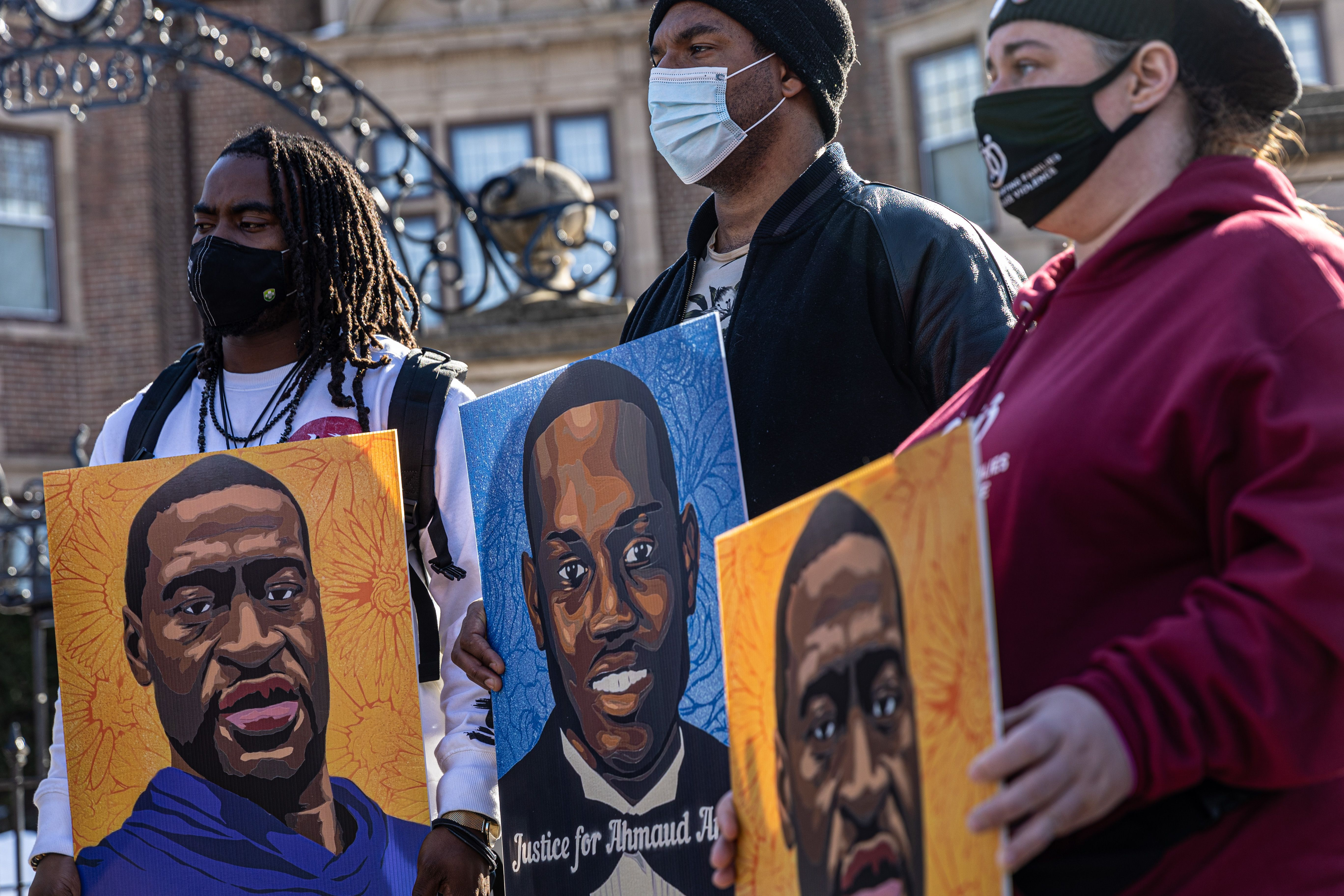 Activists hold pictures of George Floyd and Ahmaud Arbery outside outside Minnesota Governor's residence in St Paul, Minnesota