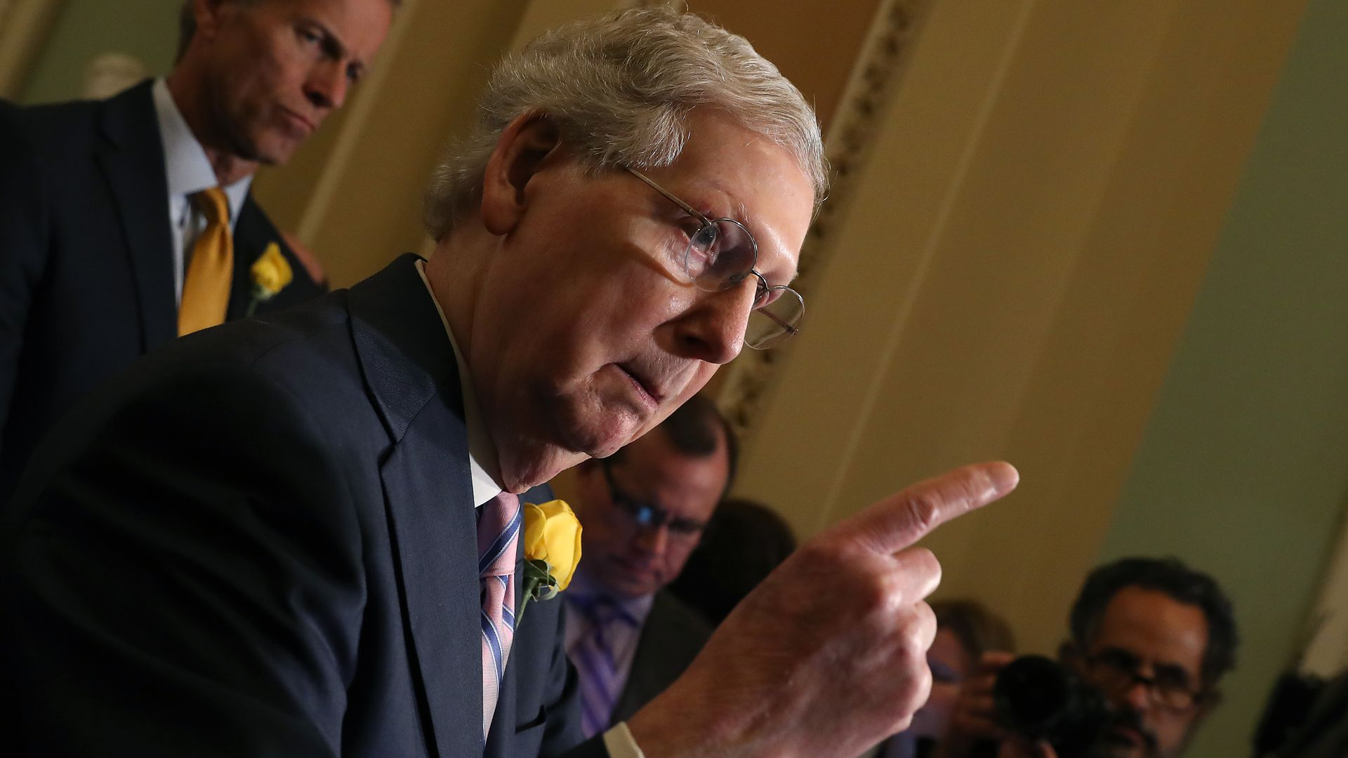 In this image, McConnell speaks while pointing a finger.