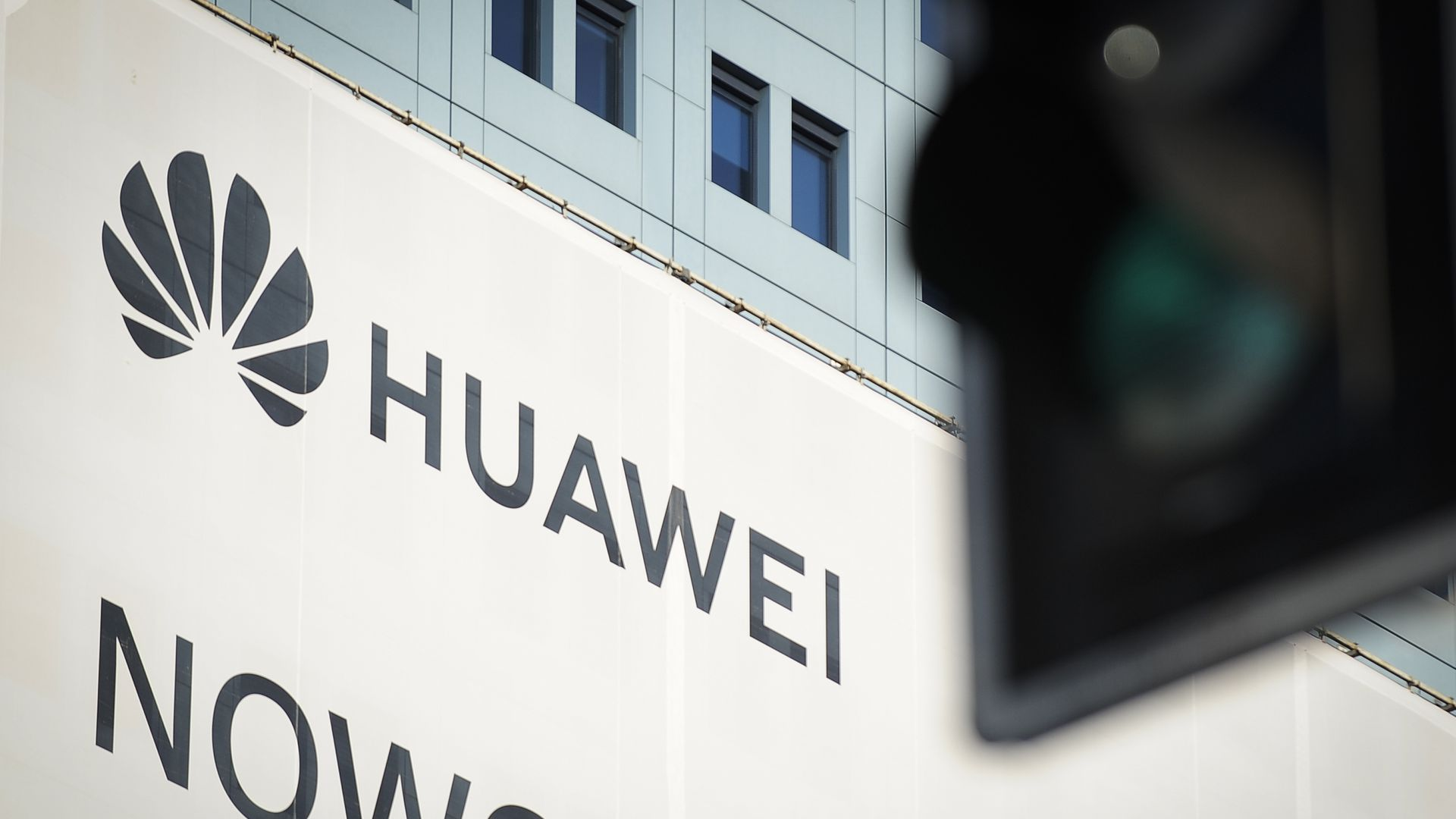 A sign with the Huawei logo