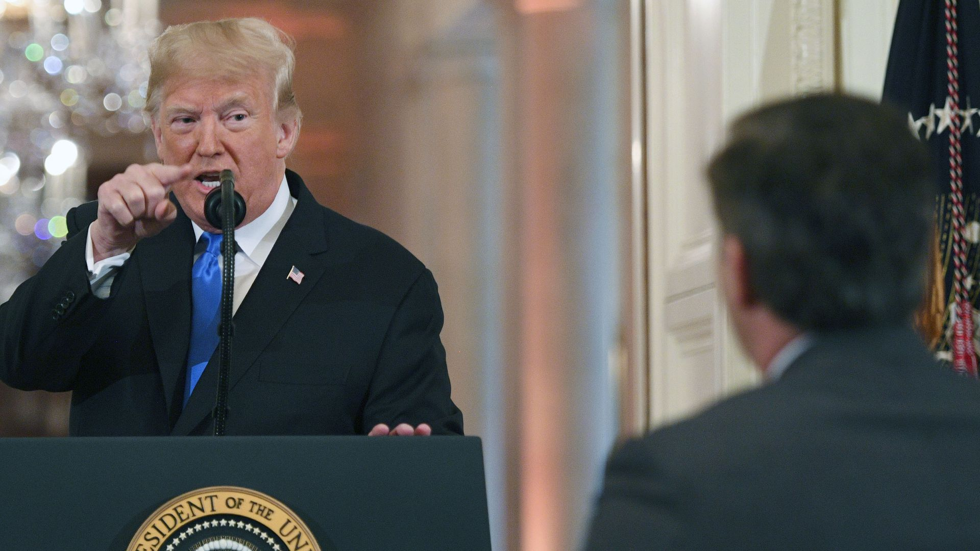 President Donald Trump points to journalist Jim Acosta from CNN during a post-election press conference