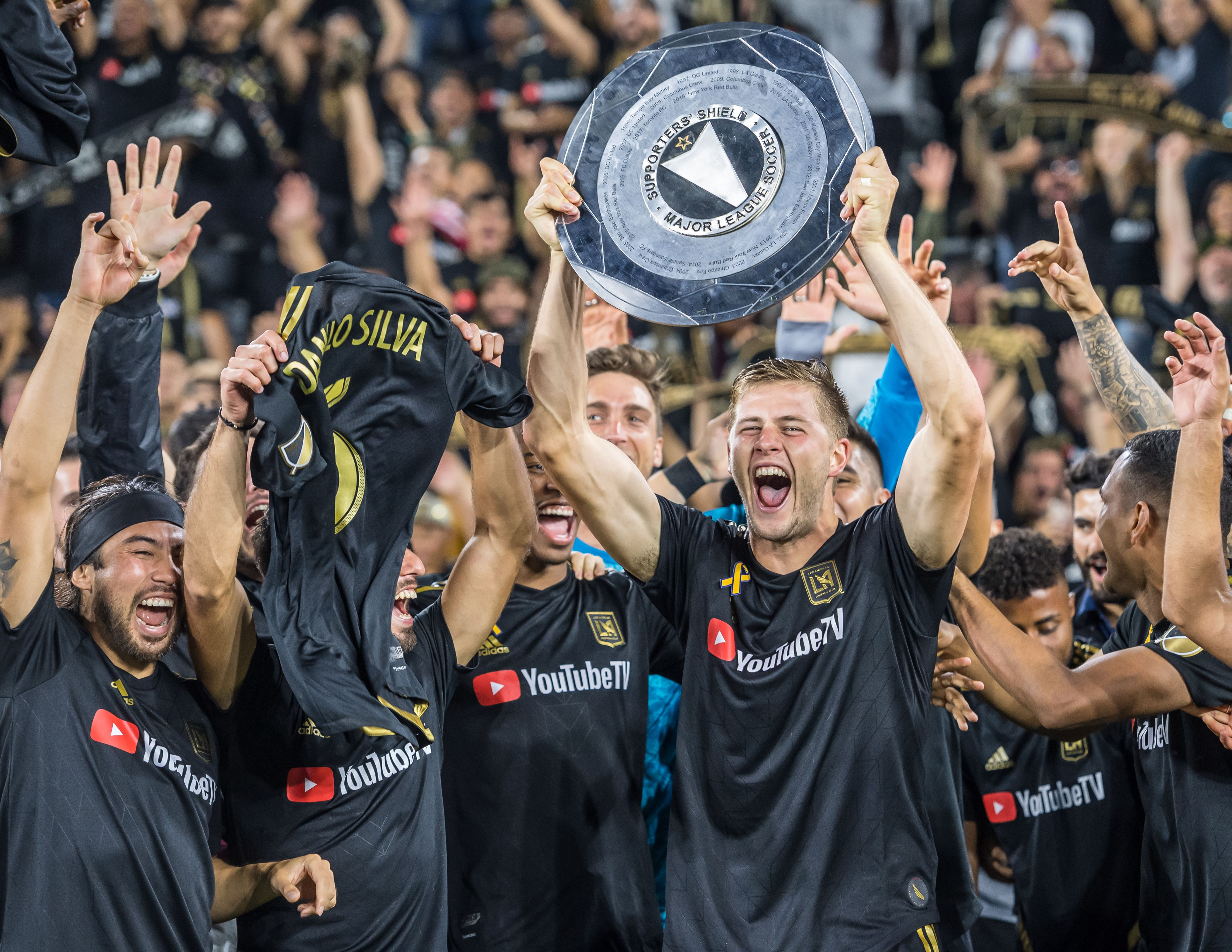 LAFC players holding the Supporters' Shield