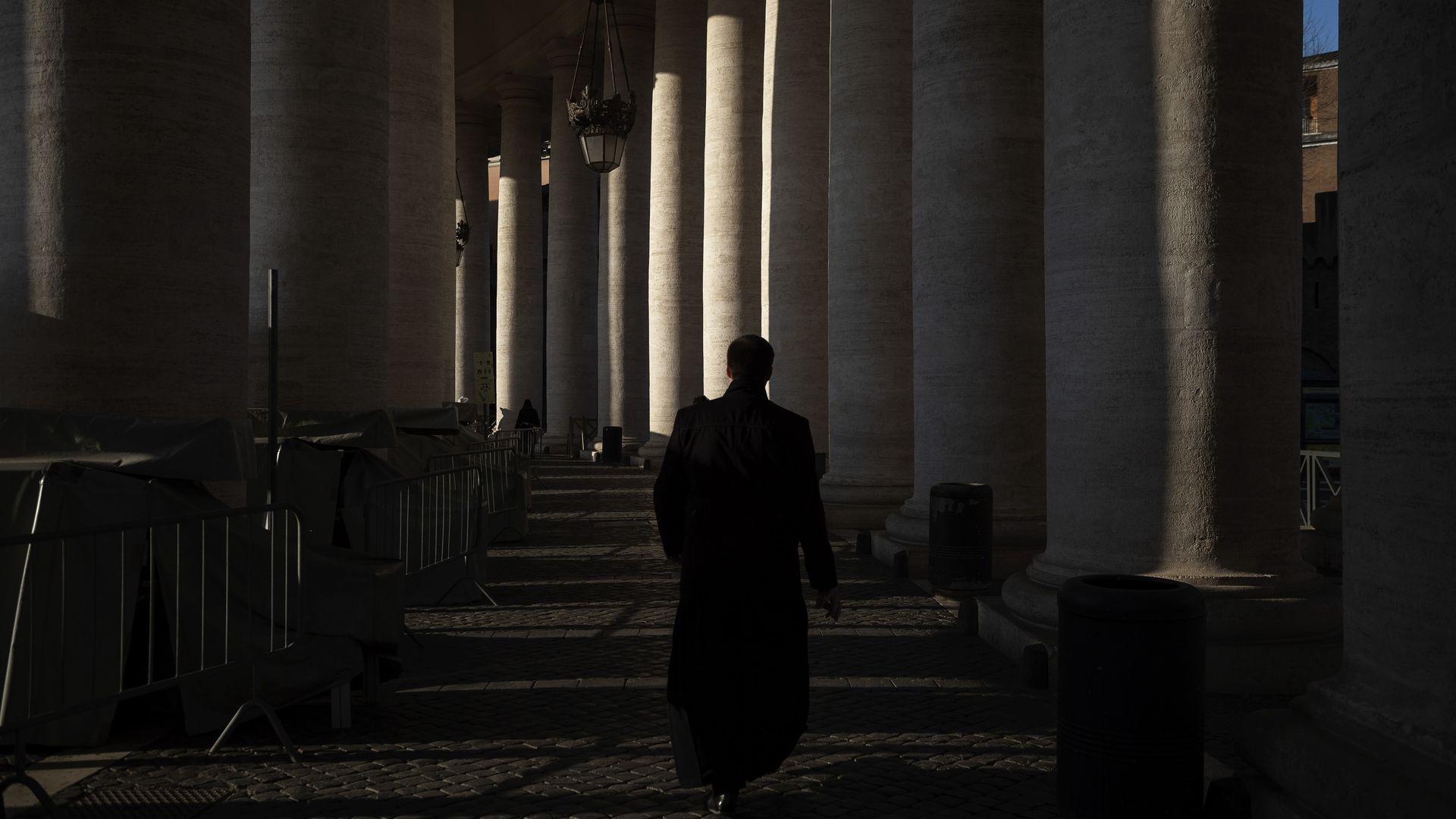 Priest walking in Vatican