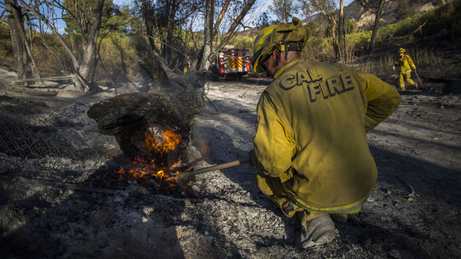 A firefighter controls a hotspot of the Maria Fire, in Santa Paula, Ventura County, California