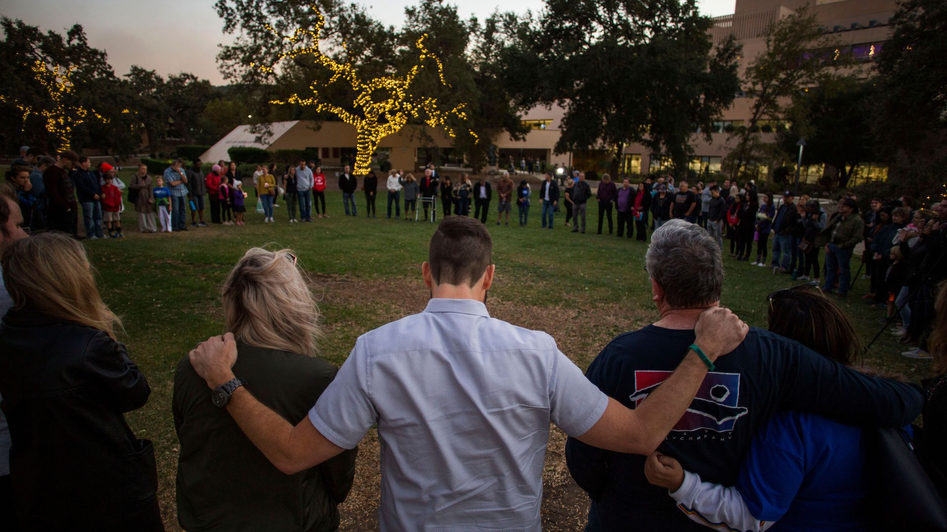 People in a circle at a vigil.