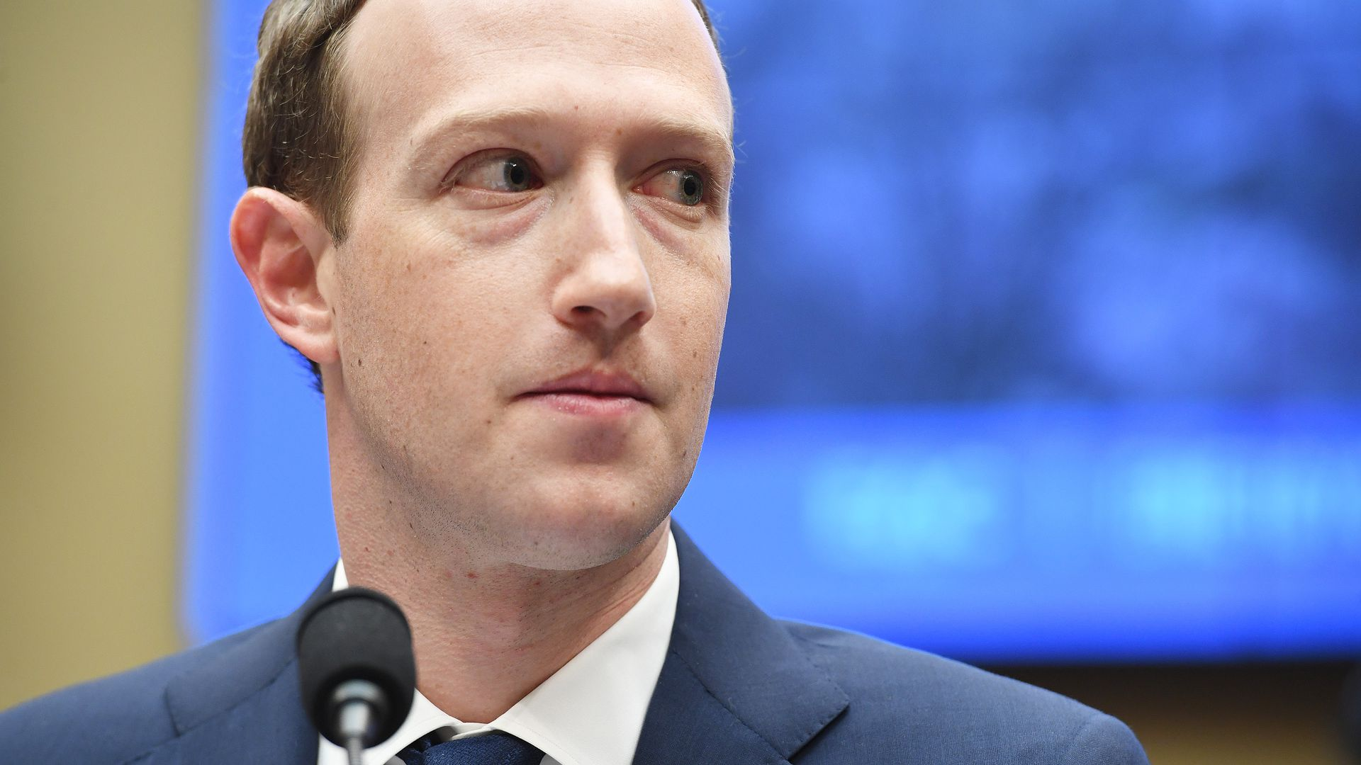 A close-up shot of Facebook's Mark Zuckerberg wearing a suit