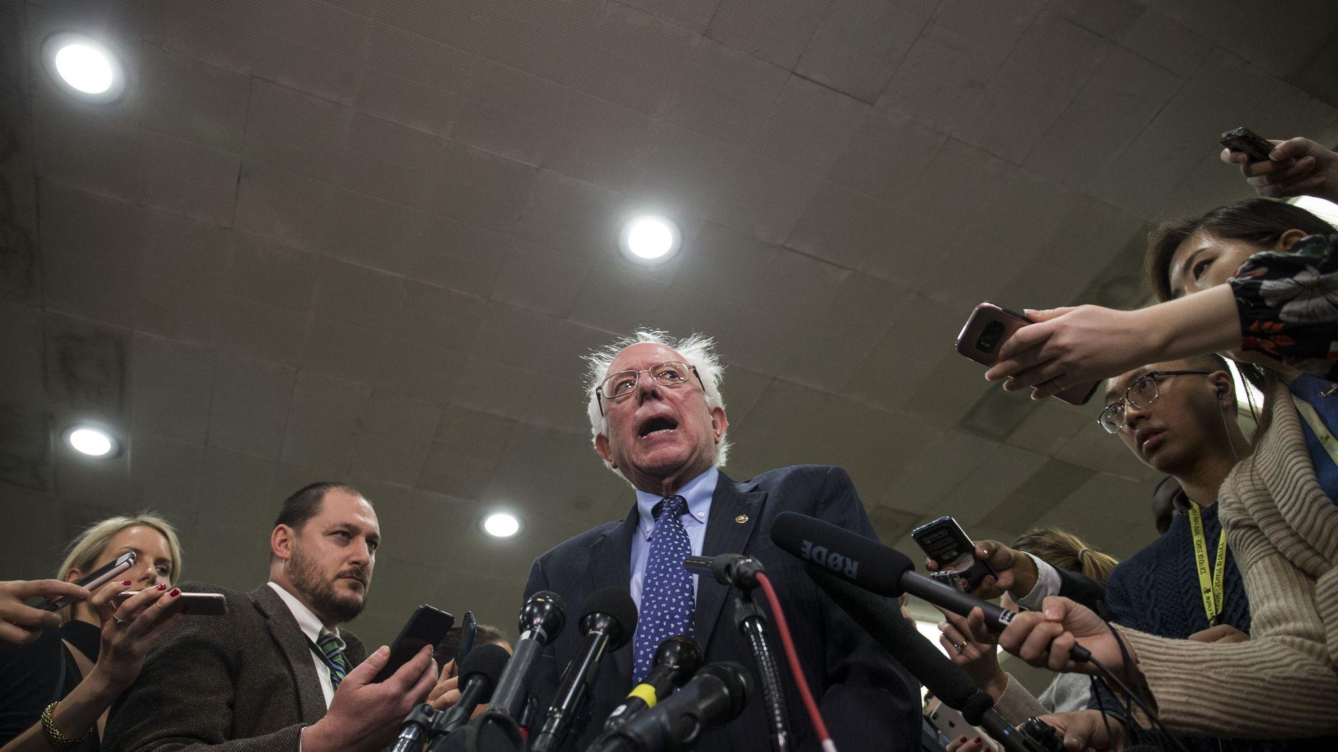 Bernie Sanders speaking to reporters.