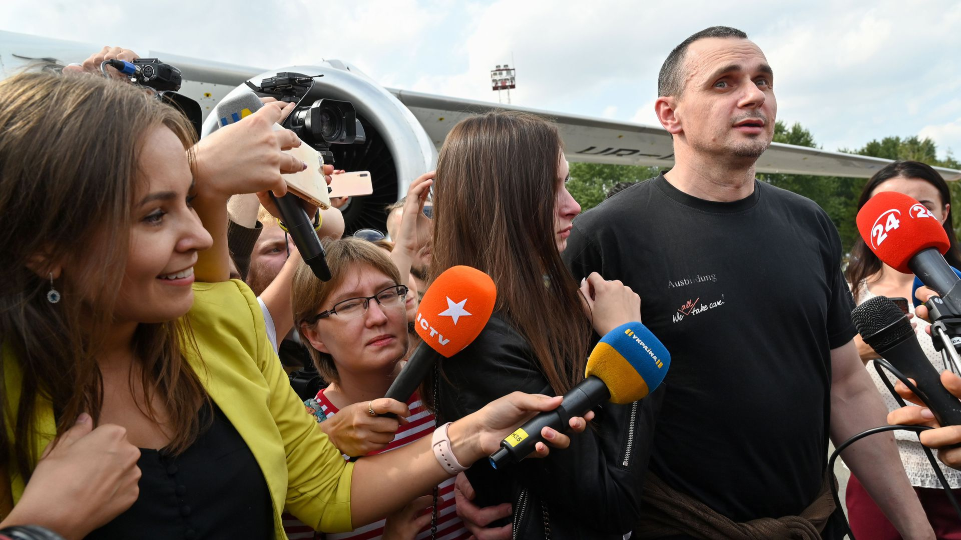 Ukrainian filmmaker and activist Oleg Sentsov chats with reporters after being released from Russia
