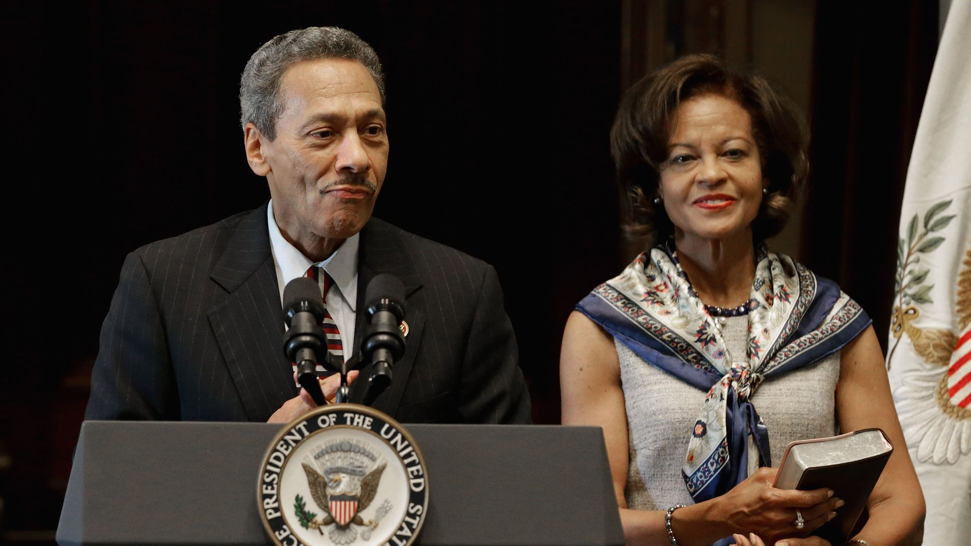 Federal Housing Finance Agency Director Mel Watt  delivers remarks after being sworn. His wife Eulada Watt  stands by his side.