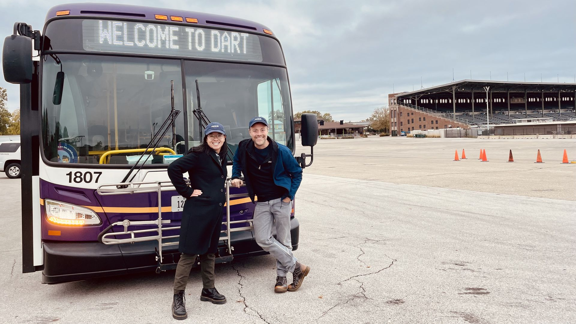 A photo of Linh Ta and Jason Clayworth in front of  a DART bus at the fairgrounds. Photo courtesy of DART