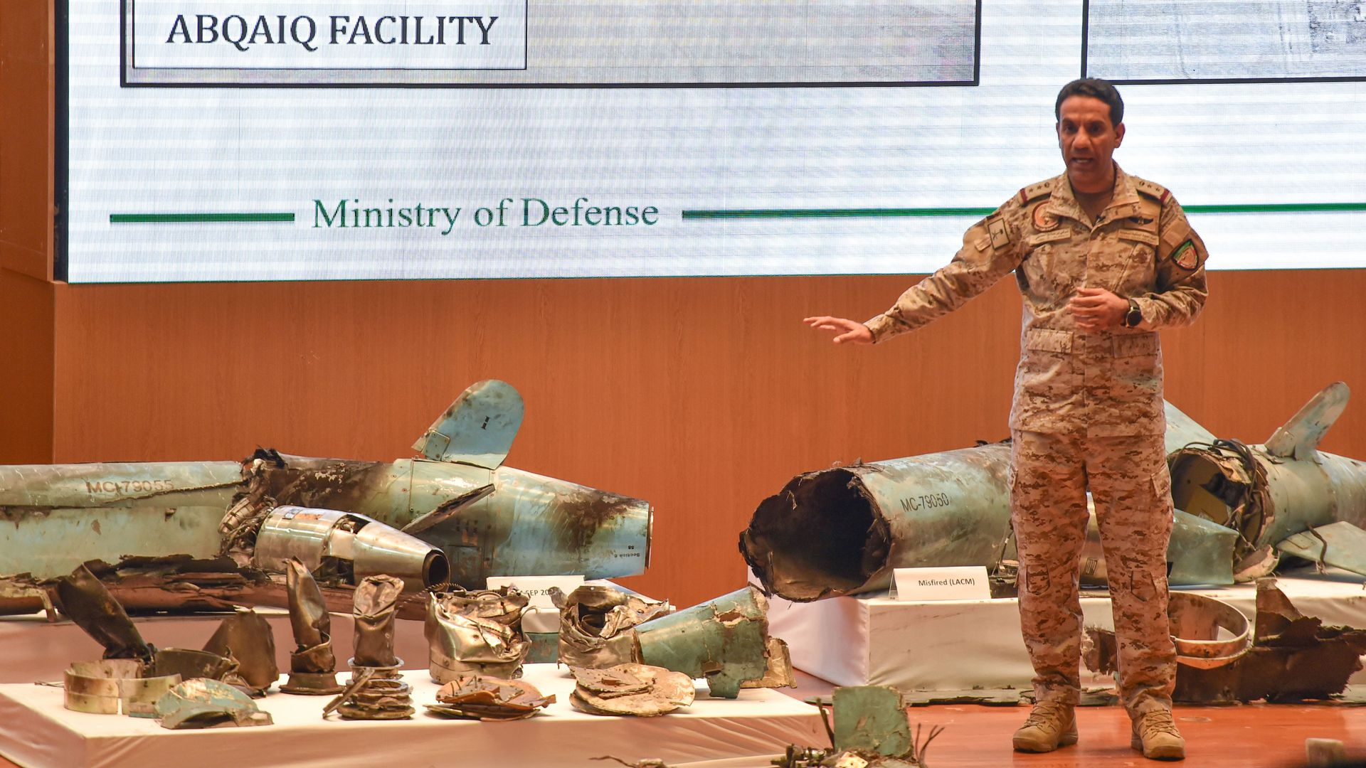 Saudi defense minister on stage with weapons remnants from the weekend's attack on its oil facilities