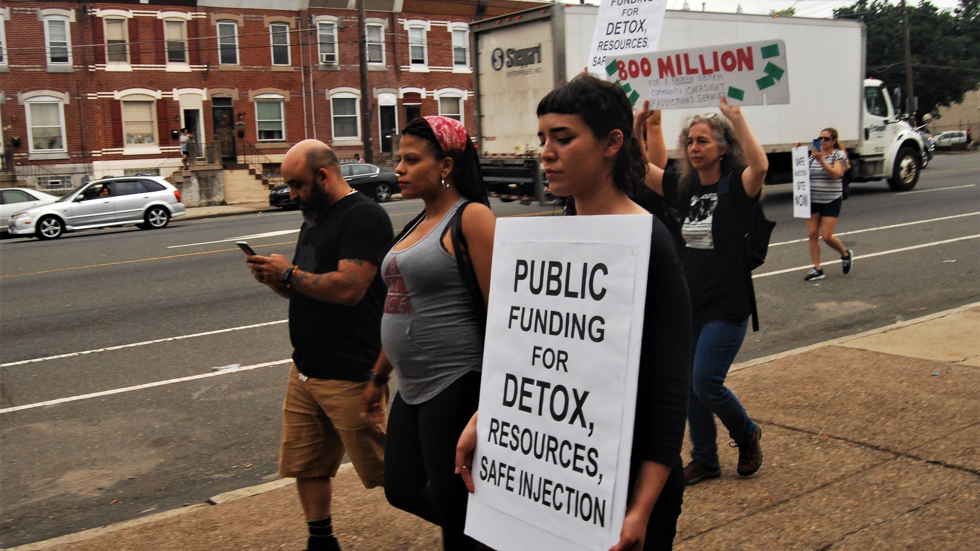 Advocates, activists and homeless folks protest through the streets of Kensington to demand adequate shelter and treatment beds