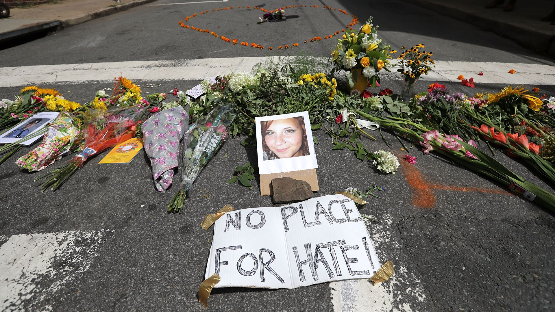 "A memorial on the street to Heather Heyer, with a sign that reads: ""No place for hate."""