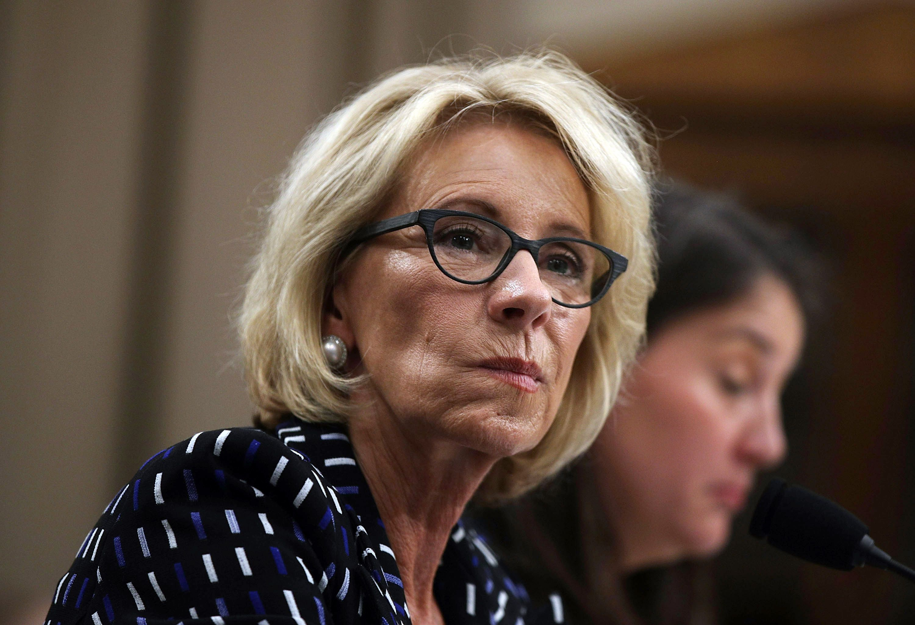 Report: DeVos dismantles team probing fraud at for-profit colleges - Axios