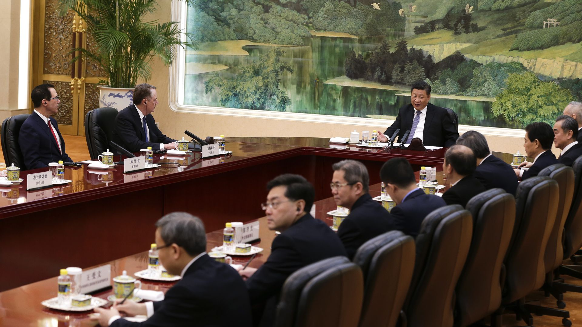 In this image, Chinese President Xi Jinping speaks at a trade summit along with U.S. representatives.