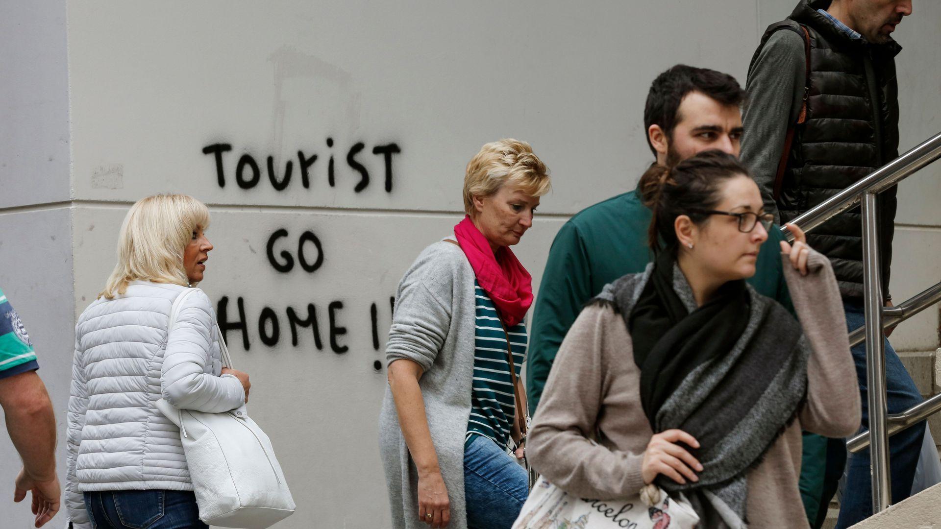 """Graffiti that says """"Tourist go home"""""""
