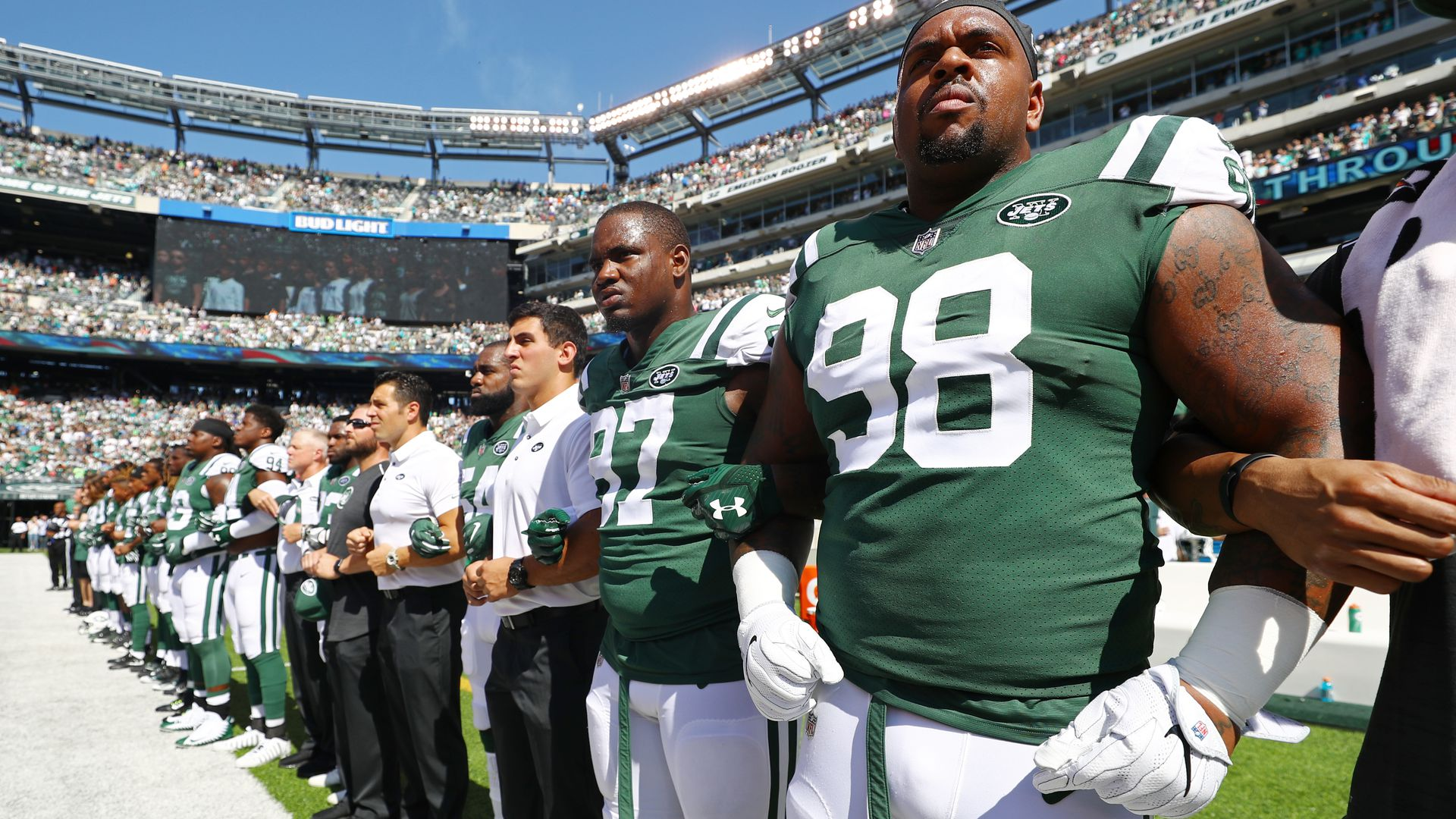 New York Jets players and coaches during the national anthem