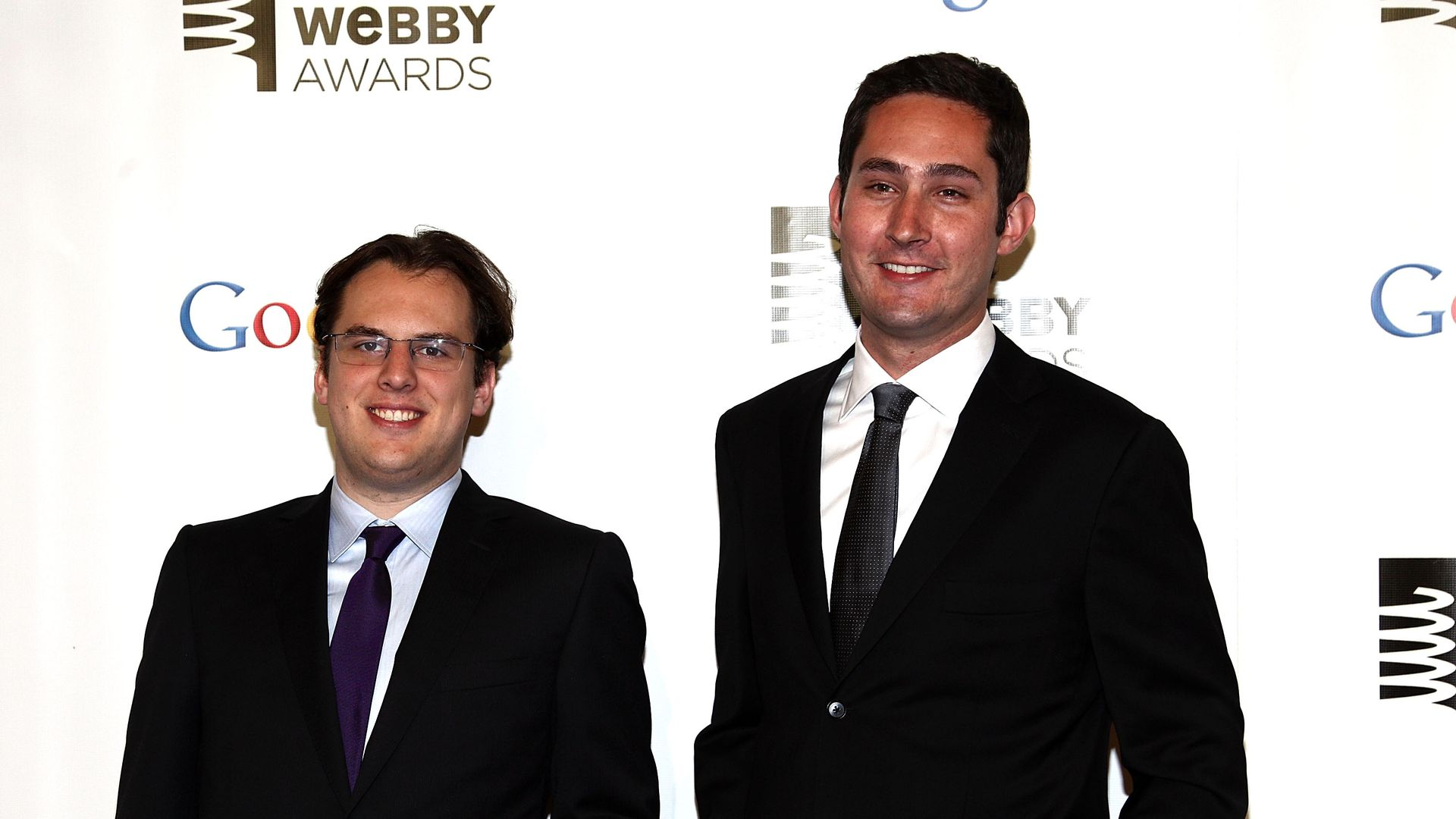 Instagram co-founders Kevin Systrom and Mike Krieger pose at for a photo at an event