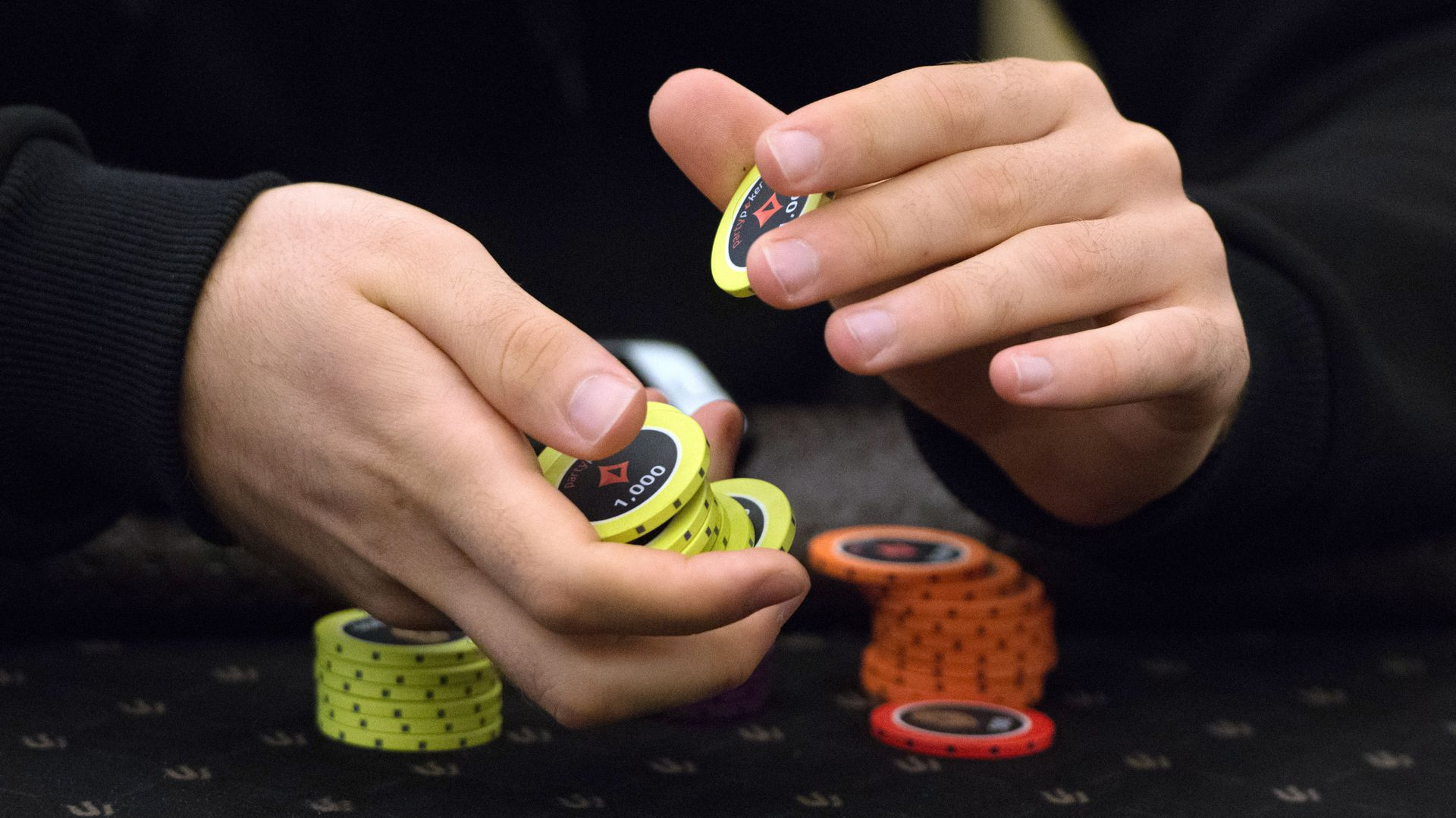 A person holding poker chips.